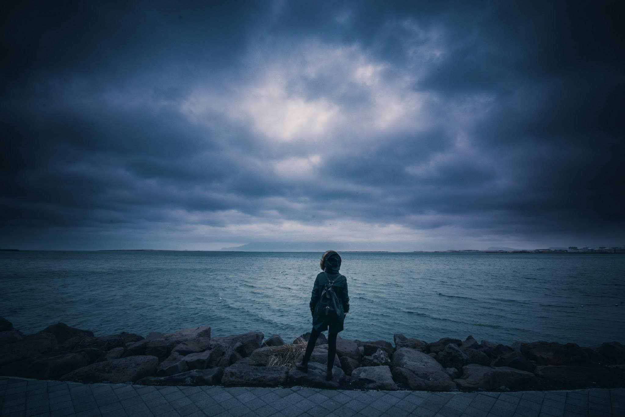 A man with depression looking out over the water